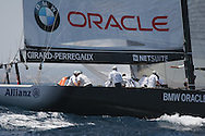 America's BMW Oracle Racing team hoists spinnaker during America's Cup fleet race; Valencia, Spain.