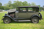 Old Westbury, New York, USA. June 2, 2019. The gray 1928 Studebaker Dictator, Club Sedan, owned by Keith Gramlich of East Meadow, is a vintage car entry on display with its hood folded open, at the 53rd Annual Spring Meet Antique Car Show, sponsored by the Greater NY Region (NYGR) of the Antique Automobile Club of America (AACA), at Old Westbury Gardens, a Long Island Gold Coast estate.