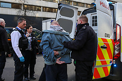 © Licensed to London News Pictures. 10/01/2020. London, UK. A protester is detained by the police as hundreds of Australians and campaigners from Extinction Rebellion climate change movement group protest in central London against the Australian government's failure to respond to the bush fires and address the climate and ecological crisis. Photo credit: Dinendra Haria/LNP