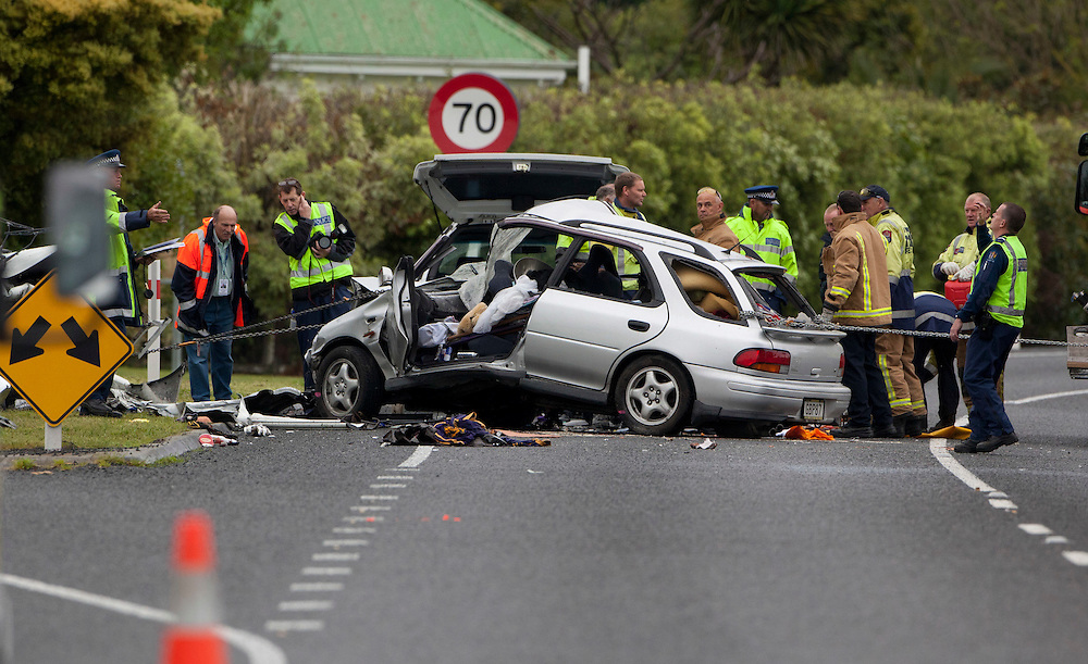 Police and fire work to remove a body after a fatal car crash at Bay View north of Napier, New Zealand, Saturday, October 22, 2011 Credit: SNPA / John Cowpland