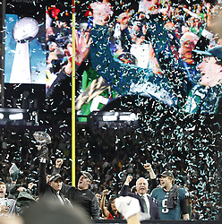 February 4, 2018 - Minneapolis, MN, USA - Philadelphia Eagles Ganeral Manager Howie Roseman holds aloft the Vince Lombardi Trophy after his team defeated the New England Patriots 41-33 in Super Bowl LII on Sunday, Feb. 4, 2018, in Minneapolis, Minn. With him were, from left, coach Doug Pederson, owner Jeffrey Lurie and quarterback Nick Foles. (Credit Image: © Carlos Gonzalez/TNS via ZUMA Wire)
