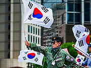 09 JUNE 2018 - SEOUL, SOUTH KOREA: A speaker waves the South Korean flag during a pro-American rally in downtown Seoul. Participants said they wanted to thank the US for supporting South Korea and they hope the US will continue to support South Korea. Many were also opposed to ongoing negotiations with North Korea because they don't think Kim Jong-un can be trusted to denuclearize or to not attack South Korea.    PHOTO BY JACK KURTZ