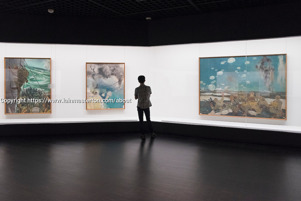 Man looking at modern paintings at National Museum of  Modern Art  in Tokyo Japan