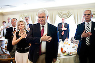 Republican presidential hopeful Newt Gingrich says the pledge of allegiance during a campaign stop at the Cedar Rapids Country Club on Thursday, August 4, 2011 in Cedar Rapids, IA.