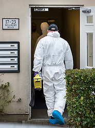 © Licensed to London News Pictures. 05/01/2019. Farnham, UK. Police forensics officers enter a property in Farnham, Surrey where a couple were arrested in connection with the murder of a man on a train yesterday. A murder investigation has been launched after the man was attacked while on board the 12. 58pm train service travelling between Guildford and London Waterloo. A man and a woman have been detained by police in Farnham in connection with the murder. Photo credit: Peter Macdiarmid/LNP