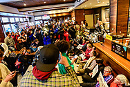 Following the controversial arrests of two black men in a Starbucks outlet in Philadelphia, dozens of protesters again sat in demanding the multinational chain to take responsibility for racist practices and contributing to the over-policing of black and brown people in the United States.