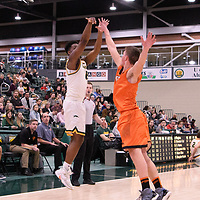3rd year forward Shaquille Harris (6) of the Regina Cougars in action during the Men's Basketball Play-In game on February  8 at Centre for Kinesiology, Health and Sport. Credit: Arthur Ward/Arthur Images