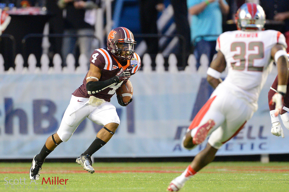 Virginia Tech Hokies running back J.C. Coleman (4) runs upfield during the Hokies 13-10 overtime win against the Rutgers Scarlet Knights in the Russell Athletic Bowl on Dec 28, 2012 in Orlando, Florida. .©2012 Scott A. Miller..