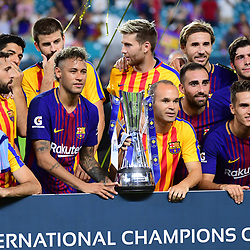 Andres Iniesta of Barcelona (right of trophy) and Neymar Jr of Barcelona (left of trophy) lift the International Champions Cup after the International Champions Cup match between Barcelona and Real Madrid at Hard Rock Stadium on July 29, 2017 in Miami Gardens, Florida. (Photo by Dave Winter/Icon Sport)