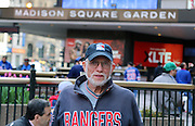 May 13, 2015 - New York, NY. Harry, a season ticket holder for over 40 years, patiently awaits his daughter to enter Game 1 of the Rangers-Capitals series. Photograph by Anthony Kane/NYCity Photo Wire