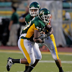 10 September 2009:  Southeastern Louisiana Lions quarterback Brian Babin (10) hands off to running back Zeke Jones (33) during a game between Southeastern Louisiana University Lions and Union College at Strawberry Stadium in Hammond, Louisiana.