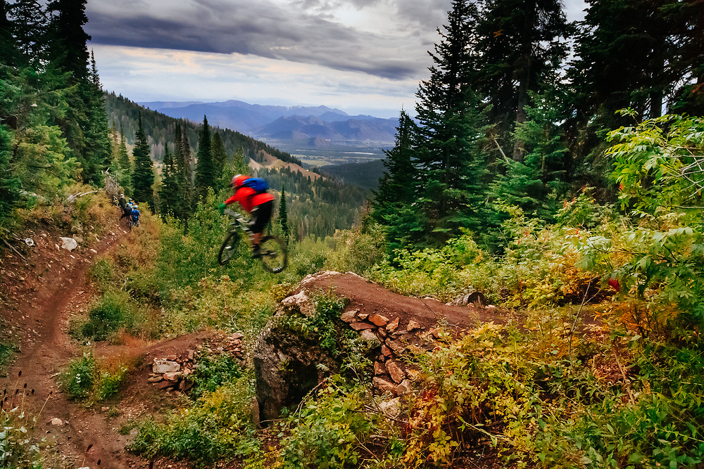 Andrew Whiteford drops a major feature on one of the trails off of Teton Pass near Jackson, Wyoming.