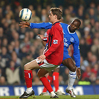 Photo: Daniel Hambury, Digitalsport<br /> Chelsea v West Bromwich Albion.<br /> FA Barclays Premiership.<br /> 15/03/2005.<br /> Chelsea's Claude Makelele and West Brom's Geoff Horsfield battle for the ball
