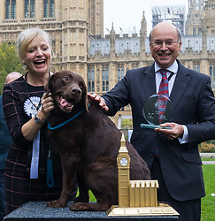 London, October 26 2017. Champions Tracy Barbin MP and her Labrador Rocky pose for pictures with Animal Welfare Minister Lord Gardinaer at the annual Kennel Club and Dogs Trust Westminster Dog Of The Year competition that sees MPs and members of the House of Lords with their dogs as well as rescue dogs from the Dogs Trust. © Paul Davey
