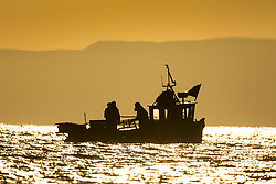 © Licensed to London News Pictures. 12/11/2018. Scarborough UK. Fisherman prepare lobster pot's on their boat at sunrise this morning in Scarborough on the Yorkshire coast. Photo credit: Andrew McCaren/LNP