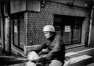 Space which for over a decade housed a convenient store remains vacant after the store went out of business, Hatagaya, Tokyo, Japan.