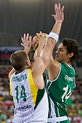 Marijonas Petravicius of Lithuania vs Jurica Golemac (14) of Slovenia during the EuroBasket 2009 Group F match between Slovenia and Lithuania, on September 12, 2009 in Arena Lodz, Hala Sportowa, Lodz, Poland.  (Photo by Vid Ponikvar / Sportida)