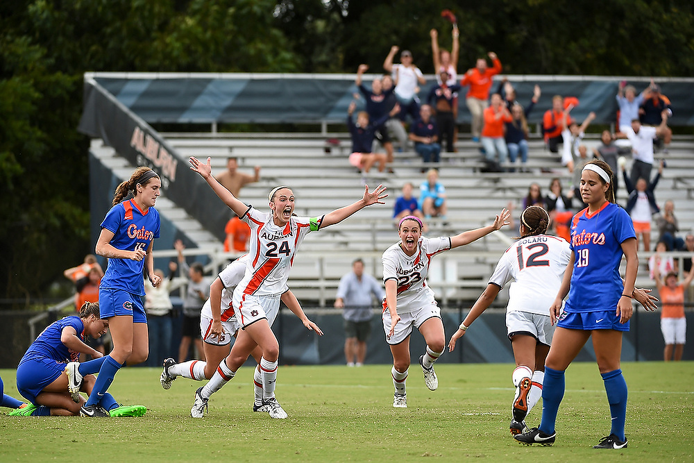 Casie Ramsier (24) celebrates scoring the game-winning goal to upset No. 9 Florida. <br /> No. 9 Florida Gators vs. No. 13 Auburn Tigers in Auburn, Ala. on Sunday, Sept. 27, 2015.  <br /> Zach Bland/Auburn Athletics
