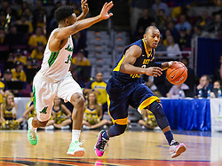 Dec 17, 2015; Charleston, WV, USA; West Virginia Mountaineers guard Jevon Carter (2) dribbles the ball down the floor while being defended by Marshall Thundering Herd guard C.J. Burks (14) during the first half  at the Charleston Civic Center . Mandatory Credit: Ben Queen-USA TODAY Sports
