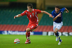 CARDIFF, WALES - Friday, September 5, 2008: Wales' Gareth Bale and Azerbaijan's Djavid Huseinov during the opening 2010 FIFA World Cup South Africa Qualifying Group 4 match at the Millennium Stadium. (Photo by Gareth Davies/Propaganda)