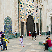 Women strolling at the Hassan II Mosque in Casablanca, Morocco on 8 September 2013. The mosque in the largest in Morocco and the seventh largest in the world, and is a popular place for families and young couples to meet.