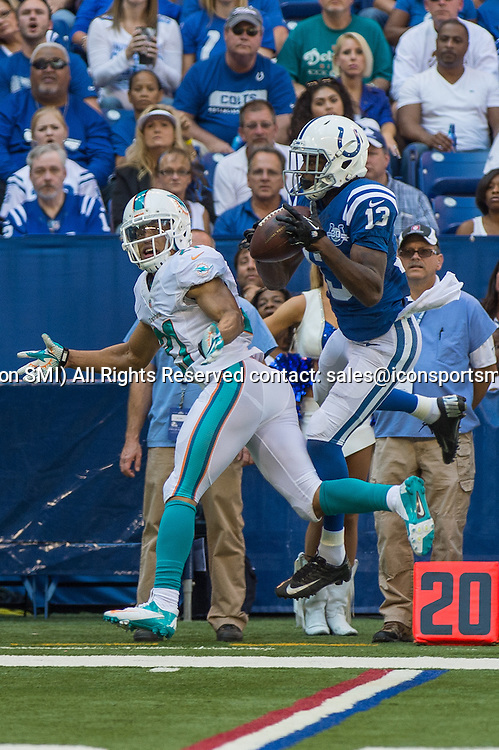 September 15, 2013: Indianapolis Colts wide receiver T.Y. Hilton (13) catches a pass over Miami Dolphins cornerback Brent Grimes (21) during the football game between the Indianapolis Colts vs Miami Dolphins at Lucas Oil Stadium in Indianapolis, IN.