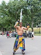 A balancing act at the roller disco in Central Park, New York City.