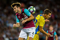 Havard Nordtveit of West Ham and Marko Alvir of NK Domzale during 2nd Leg football match between West Ham United FC and NK Domzale in 3rd Qualifying Round of UEFA Europa league 2016/17 Qualifications, on August 4, 2016 in London, England.  Photo by Ziga Zupan / Sportida