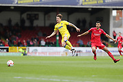 AFC Wimbledon midfielder Jake Reeves (8) and Swindon Town midfielder Conor Thomas (4) during the EFL Sky Bet League 1 match between Swindon Town and AFC Wimbledon at the County Ground, Swindon, England on 14 April 2017. Photo by Stuart Butcher.