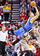 Jan 24, 2016; Houston, TX, USA; Dallas Mavericks forward Dwight Powell (7) shoots while laying on the back of Houston Rockets guard Jason Terry (31) in the second quarter at Toyota Center. Mandatory Credit: Thomas B. Shea-USA TODAY Sports