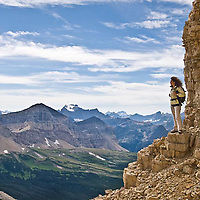 woman overlooking glacier national park from the cliff on chief mountain, glacier national park, montana, crown of the continent