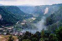 West Sumatra, Bukittinggi. Sianok canyon (Ngarai Sianok) is a steep valley (ravine) located in Bukittinggi, about 15 km long. Houses at the valley floor.