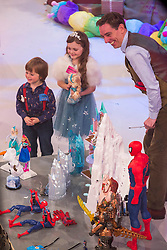 Ryan Tubridy is pictured with toy demonstrators Jamie (6) and Holly-Belle Hennessey from Meath on the Late Late Toy Show 2014. Picture Andres Poveda