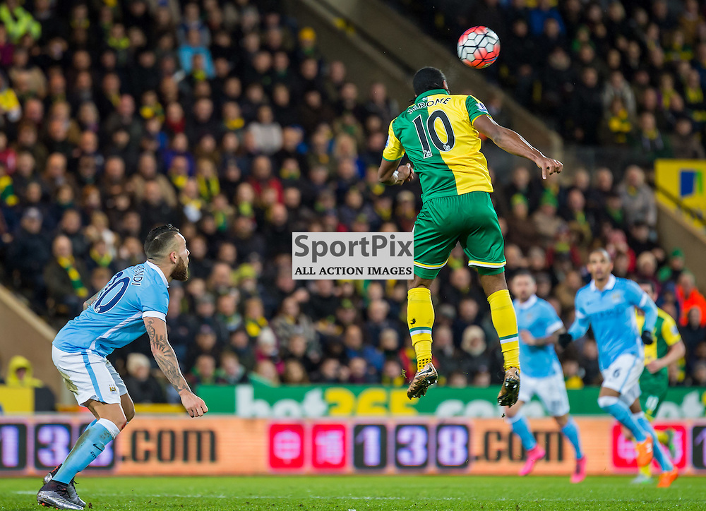 Norwich City forward Cameron Jerome (10) rises high to get in a header as Manchester City defender Nicolas Otamendi (30) looks on