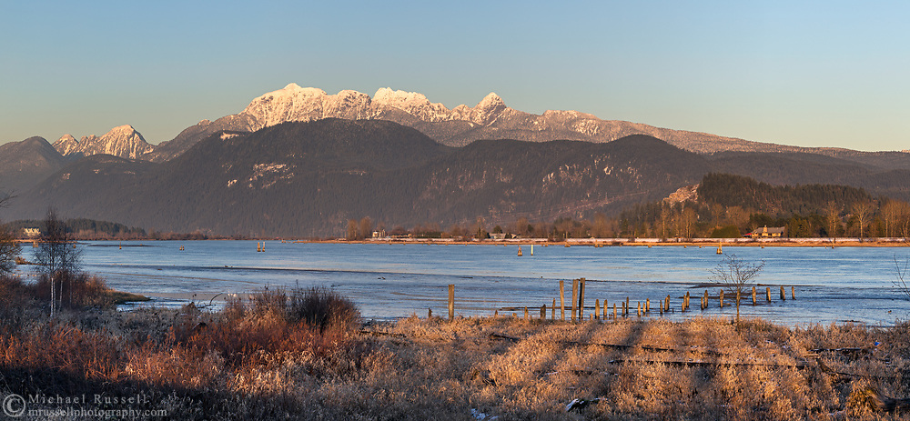 The Golden Ears (Mount Blandshard - including Edge Peak, Blandshard Needle, and Alouette Mountain) with Raven Peak on the left.  Photographed from the Traboulay PoCo Trail along the Pitt River in Port Coquitlam, British Columbia, Canada.
