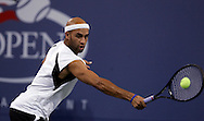 James Blake of the US returns a backhand to Carlos Moya of Spain in their third round match on the seventh day of the 2006 US Open tennis tournament in Flushing Meadows New York Sunday 03 September 2006. (Andrew Gombert) for The New York Times