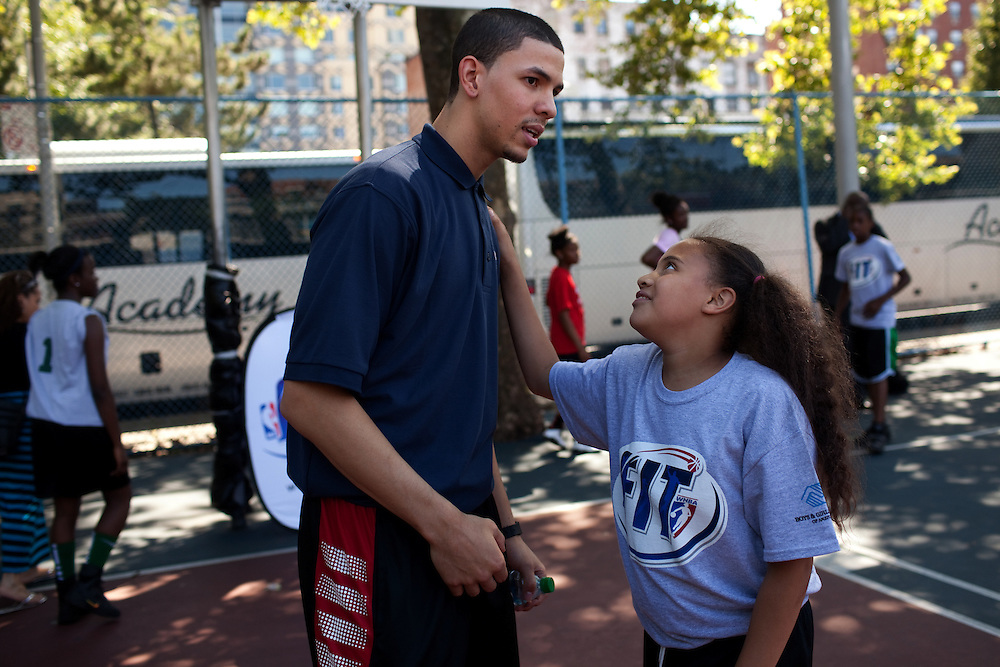 {June 27, 2012} {4:00pm} -- New York, NY, U.S.A.Duke basketball star Austin Rivers talks with Chayanne Kelly, 10, from Harlem at the Dunlevy Milbank Boys & Girls Club before the NBA draft Thursday in Manhattan, New York on June 27, 2012. .