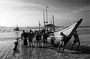 Sri Lanka. On the south Coast bay of Weligama, fishermen launch a fishing boat.