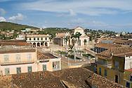 An aerial view of the terracotta roofs of Trinidad and the Iglesia Parroquial<br /> de la Santisma Trinidad<br /> Trinidad, Cuba