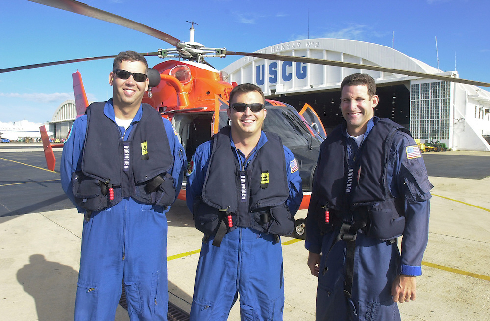 Aircrew of a USCG HH-65B helicopter, stationed at Coast Guard Air Station Borinquen in Puerto Rico. The primary mission of the Station is search and rescue.  (U.S. Air Force photo/Master Sgt. Lance Cheung)