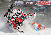 A rider looses control of his sled during a race at the AMSOIL Snocross Championships in Lake Geneva, Wi., Sunday, March 17, 2013. Jeffrey Phelps for the New York Times.