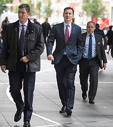 © Licensed to London News Pictures. 14/06/2019. London, UK. Foreign Secretary JEREMY HUNT is seen flanked by security as he arrives at BBC Broadcasting House in London ahead of a BBC radio interview. Boris Johnson has cemented his position as favourite to become the next Prime Minster after winning a landslide in the first round of the conservative party's leadership race, with Jeremy Hunt a distant second. Photo credit: Ben Cawthra/LNP
