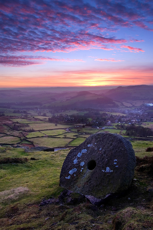 Millstones are regularly found in the Peak District. This one is nicely positioned to complement the stunning colours as another day reaches its end.