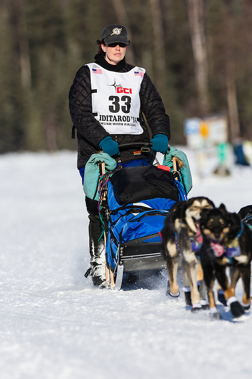 Musher Karin Hendrickson competing in the 42nd Iditarod Trail Sled Dog Race on Long Lake after leaving the restart on Willow Lake in Southcentral Alaska.  Afternoon. Winter.