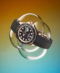 Rolex Yacht Master watch floating on bubbles.