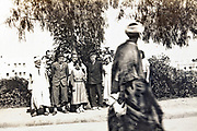 traditional Morrocan dressed man pasing while a group photo is being taken with western people Sale Morocco early 1930s