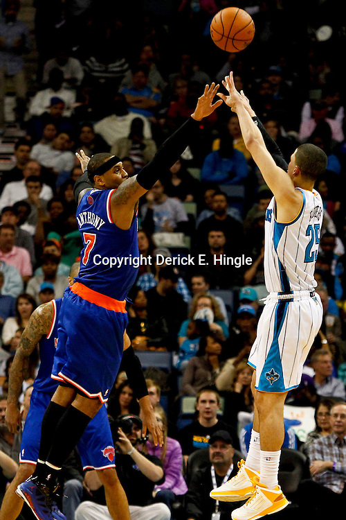 November 20, 2012; New Orleans, LA, USA; New Orleans Hornets shooting guard Austin Rivers (25) shoots over New York Knicks small forward Carmelo Anthony (7) during the first half of a game at the New Orleans Arena. Mandatory Credit: Derick E. Hingle-US PRESSWIRE