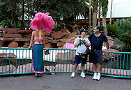 US-LAS VEGAS: Tourists looking at a showgirl at the Flamingo Hotel. PHOTO GERRIT DE HEUS