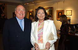 MR & MRS ANTHONY OPPENHEIMER of De Beers at auctioneers Sotheby's Summer party held at their showrooms in 34-35 New Bond Street, London W1 on 6th June 2005.<br />