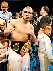 "November 10, 2007; New York, NY, USA;   WBA Welterweight Champion Miguel Cotto celebrates after his 12 round fight  against ""Sugar"" Shane Mosley at Madison Square Garden in New York, NY.   Cotto won the fight via unanimous decision."
